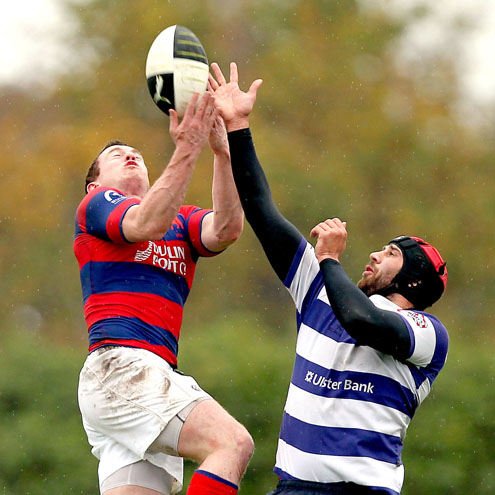 Clontarf's Killian Lett jumps for a high ball