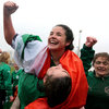 Larissa Muldoon, pictured saluting the vocal Irish support in the stand, played at half-back alongside fellow Donegal woman Nora Stapleton