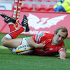 Scarlets winger Lee Williams dives over to score his third try in two Magners League games