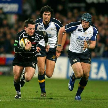 Cameron Jowitt and Jamie Heaslip chase down the Ospreys' Shaun Connor