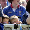 Two young fans look on as highlights of Leinster's win over Leicester Tigers are shown on the big screen