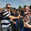 Leinster coach Michael Cheika shakes hands with a fan as the coaches and players mingle with the crowd