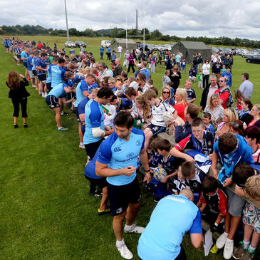 The Leinster players sign autographs for the fans