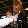 Leo Cullen's eight-week-old nephew, Fionn Quilter, is held in the Heineken Cup as the newly-crowned European champions are welcomed home
