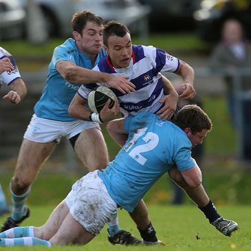 Blackrock College centre Leon Ellison is tackled