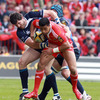 Munster centre Lifeimi Mafi tries to wrestle free from the grasp of Shane Horgan and Sean O'Brien
