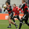 Centre Lifeimi Mafi collects a pass as the Munster players are put through their paces by the coaching staff
