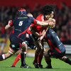 Munster's livewire centre Lifeimi Mafi looks for support as he tries to crash through the Scarlets' cover