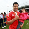 A very happy Lifeimi Mafi, who set up Doug Howlett's opening try, is pictured with his daughter Cassidy