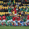 The fans look on at the 'Cake Tin' as Paul O'Connell reaches Rory Best's lineout throw ahead of Wales' Alun Wyn Jones