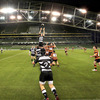 Old Belvedere hooker Mark Cooney throws the ball into a lineout during the local derby at the Aviva Stadium