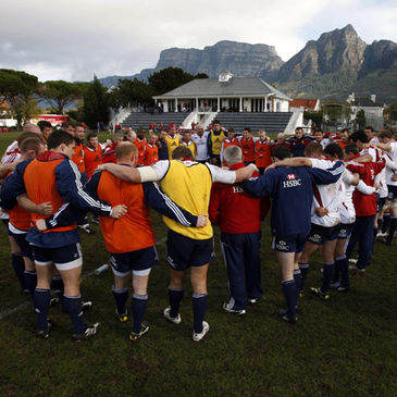 The Lions players and coaches huddle together in Cape Town