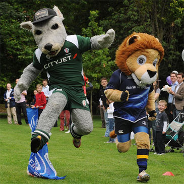 The mascots head for the finish line