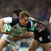 Leinster's Grand Slam-winning winger Luke Fitzgerald tries to break past Harlequins' Gonzalo Tiesi