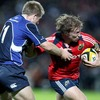 Leinster's Luke Fitzgerald challenges Munster hooker Jerry Flannery for possession at the RDS
