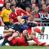Winger Luke Fitzgerald is swarmed over by three Munster players, summing up the hosts' desire to keep their try-line intact
