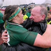 Lynne Cantwell and head coach Philip Doyle embrace after the final whistle as they await the trophy presentation