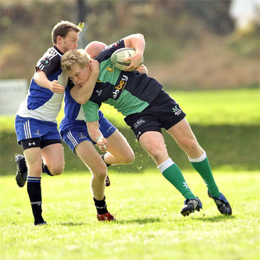 Ballynahinch's Nevin Spence is closed down by Cork Con