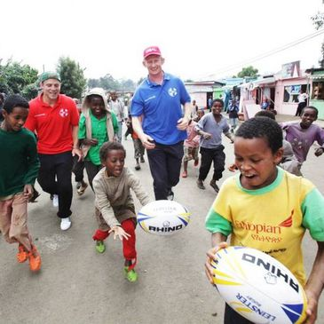 Ian Madigan and Leo Cullen with the kids in Addis Ababa
