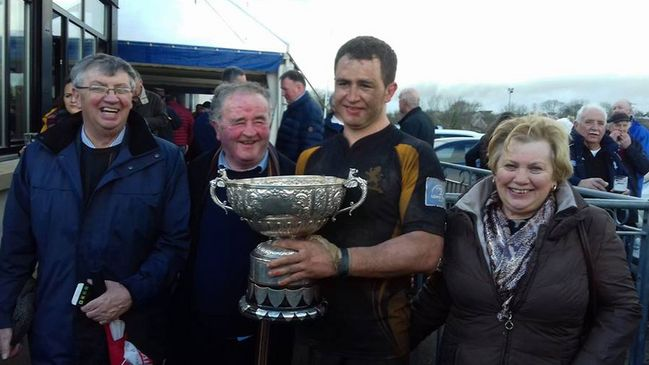 Malahide captain John Shine with the Leinster Junior League Division 1A trophy