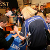 Malcolm O'Kelly had quite an audience as he signs this family's Leinster flag
