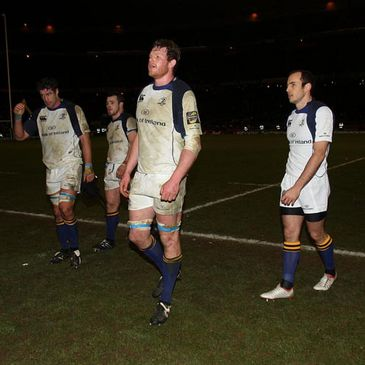 Malcolm O'Kelly and the Leinster players walk off the Twickenham pitch