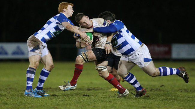 Action from Dungannon's derby defeat to Malone