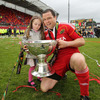 Munster prop Marcus Horan, who made 19 appearances for the province this season, is pictured holding the league trophy with his daughter Heather