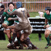 Ireland centre Joanne O'Sullivan grimaces as she ships a big hit at Esher RFC
