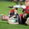 Ulster winger Mark McCrea is tackled by Diogo Gama as he tries to slide over the try line