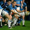 Glasgow scrum half Mark McMillan spins a pass away from a ruck as Leinster replacement prop Ronan McCormack looks on