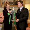 President McAleese and Ireland's Grand Slam-winning captain Brian O'Driscoll share a laugh as they hold the Championship trophy