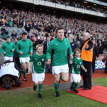 Ireland captain Brian O'Driscoll with mascots Evan McCool and Shane Mangan