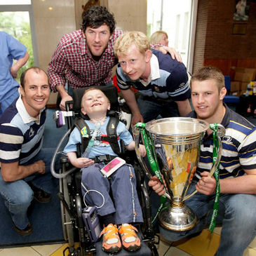 The Leinster players pose with six-year-old Matthew McGrath
