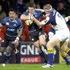Leinster's Jamie Heaslip goes high to stop the progress of Glasgow centre Max Evans