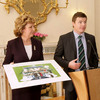 Ireland captain Brian O'Driscoll addresses the assembled audience as President McAleese holds a signed photograph given to her by the squad