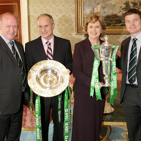 Declan Kidney and Brian O'Driscoll pose with the President and her husband Martin