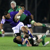 Out-half Lolo Lui, who converted Samoa's first two tries, is brought to ground by Connacht's Andrew Browne and Eoin McKeon