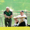 Ireland team manager Michael Kearney and pack leader Paul O'Connell watch the players train in warm sunshine