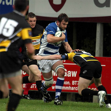 Dungannon replacement Michael Rainey takes the ball on