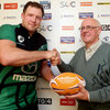 Connacht lock Michael Swift is presented with his man-of-the-match award by RaboDirect customer Ray Norton