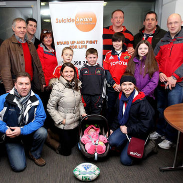 Mick O'Driscoll is pictured with the Suicide Aware representatives