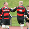 Second row colleagues Mick O'Driscoll and Paul O'Connell help each other warm up at UL