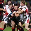 Edinburgh captain Mike Blair has nowhere to go as Ulster's Paul Steinmetz and Andrew Trimble sandwich him in a tackle