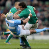 Ireland lock Mike McCarthy shrugs off a challenge from Argentina's Juan Manuel Leguizamon during the opening minutes