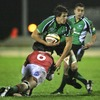 Portugal flanker Julian Bardi gets in a tackle as Connacht's Mike McCarthy looks for support