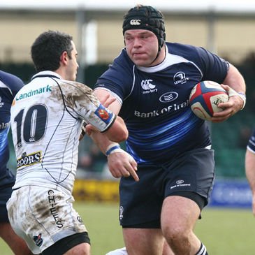 Leinster prop Mike Ross takes the ball forward