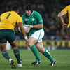 Ireland's tighthead prop Mike Ross rumbles forward with ball in hand, faced by Australia's Sekope Kepu