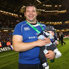 First-time Heineken Cup winner, prop Mike Ross, is pictured with his baby son Kevin who was born in February