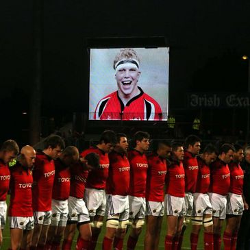 The Munster players observe a minute's silence